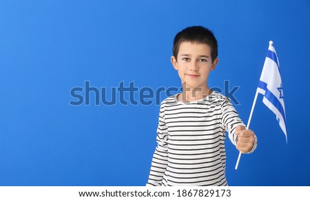 Little boy with the flag of Israel on color background Stok fotoğraf ©