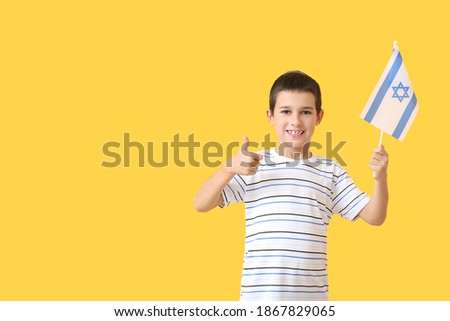 Little boy with the flag of Israel showing thumb-up on color background Stok fotoğraf ©