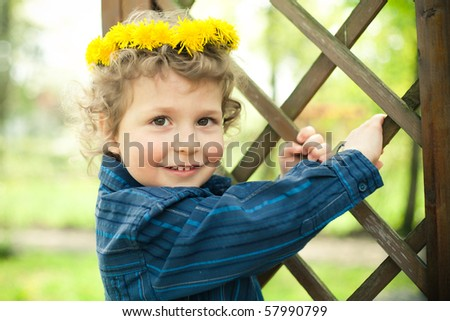 little boy with wreath