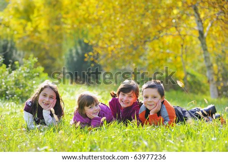 Little boys and girls laying down on grass