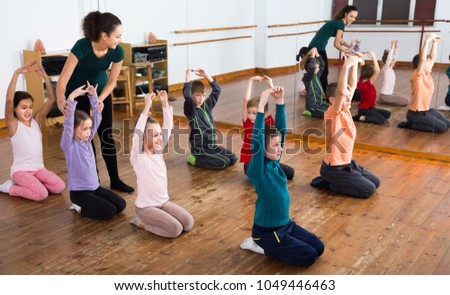 Little boys and girls studying contemp dance in junior class  #1049446463