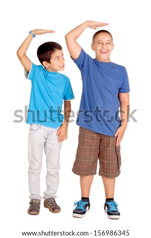 little boys trying to be taller isolated in white