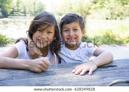 little brother and his older sister outdoor #628349828