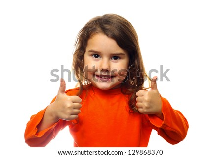 Little brunette curly girl in an orange jacket, showing two thumbs up isolated on white background