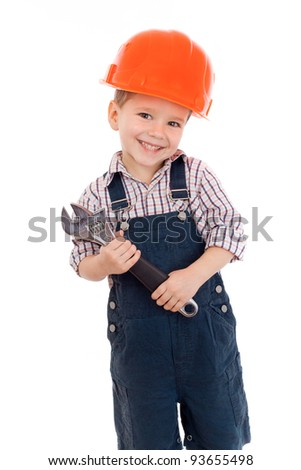 Little builder in coveralls and helmet with wrench, isolated on white