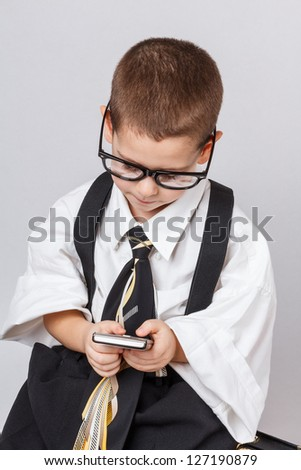 Little business man using mobile smart phone