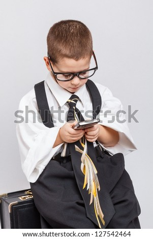 Little business man using mobile smart phone - stock photo