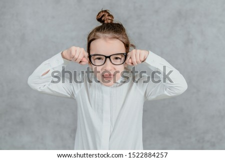 little businesswoman. little businesswoman on grey background. business lady. little businesswoman with serious and confident look. formal fashion for little businesswoman #1522884257