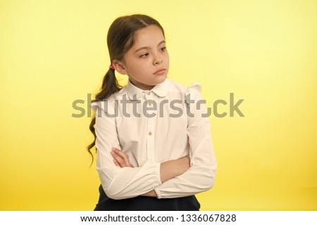 little businesswoman. little businesswoman on yellow background. business lady. little businesswoman with serious and confident look. formal fashion for little businesswoman #1336067828