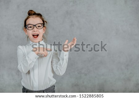 little businesswoman. little businesswoman on yellow background. business lady. little businesswoman with serious and confident look. formal fashion for little businesswoman #1522885805
