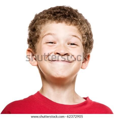 little caucasian boy portrait grimace smile isolated studio on white background