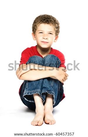 little caucasian boy portrait smiling isolated studio on white background