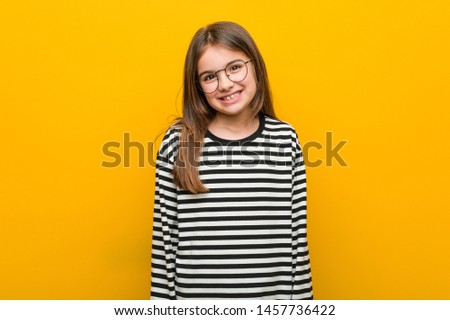 Little caucasian cute girl happy, smiling and cheerful.