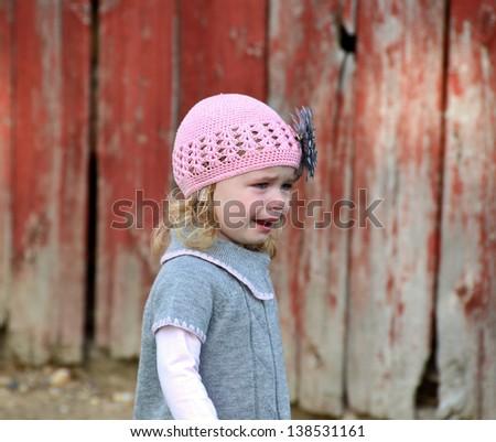 little caucasian girl in tears