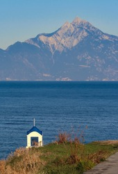 Little chapel and mount Athos as seen from Sarti old village. Halkidiki,Greece. 2019 Oct. 13