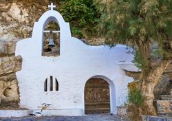 Little chapel whith bell and wooden door, Crete, Greece