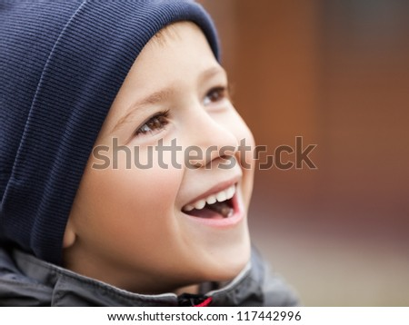 Little cheerful child boy walking outdoor and smiling for happiness and fun - stock photo
