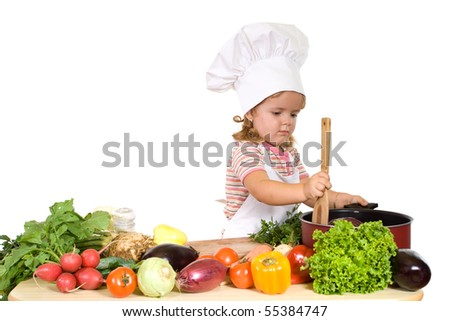Little chef preparing healthy meal with lots of different vergetables - isolated