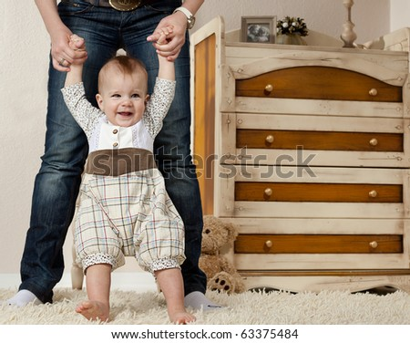 little child baby smiling making first steps