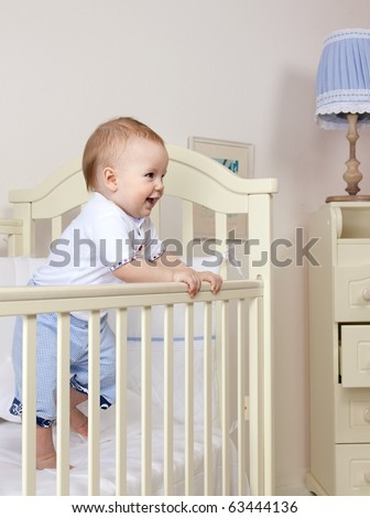 little child baby smiling on white background - stock photo