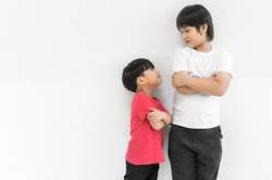 Little child boy and tall child boy standing arms crossed and looking face isolated on white background. Big and small kid concept at be friends. Back to school for concept.