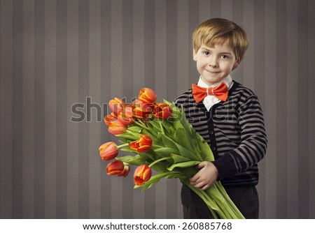 Little Child Boy Giving Flowers Bouquet, Handsome Kid Greeting Red Tulips Bunch, Retro Style Celebration, Looking at Camera
