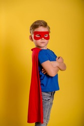 Little child boy play superhero. Happy smiling kid in glasses with star. Success, motivation concept.
