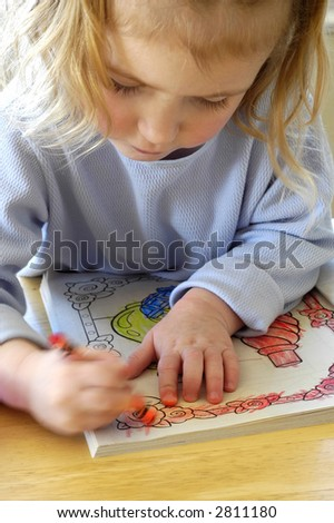 Little Child Coloring In Kid With Crayons