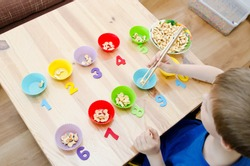 Little child doing simple math exercises. Early education, counting game. Preschool exercise for kids. Sequence from 1 to 10.
