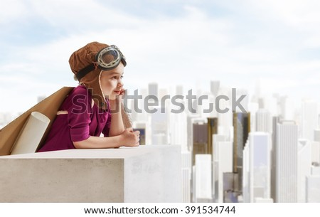 Shutterstock Little child girl plays astronaut. Child looking at city. Child in an astronaut costume plays and dreams of becoming a spaceman.