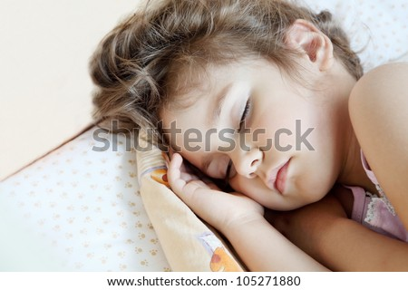 Little Child Girl Sleeping in Her Bed