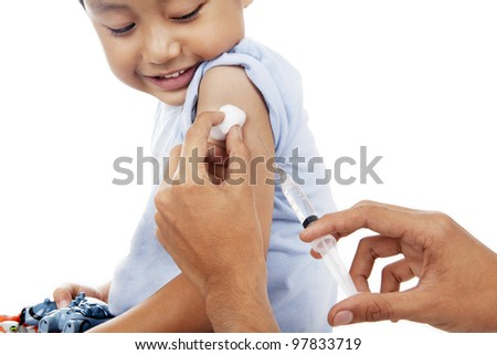 Little child have a vaccination shot in studio isolated on white