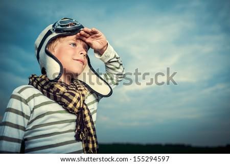 Little child in helmet and glasses