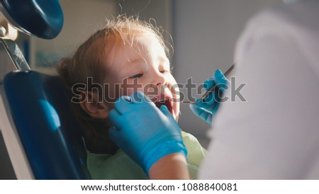Little child in stomatology chair - close up