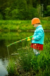 little child is fishing