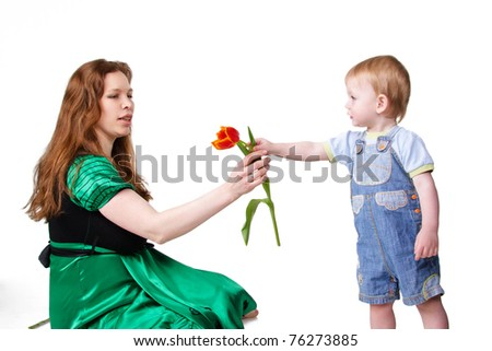 little child is giving flower to mother. Isolated on white