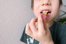 little child, kid eating sweet gelatin candies, looking forward to enjoying his favorite treat, unhealthy food concept, halal gelatin, diet