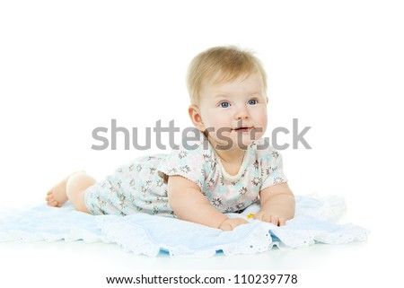 little child lies on the diaper