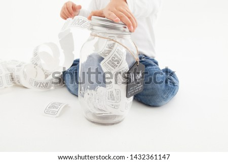 little child making lots of wishes using a wish jar, wish granted!
