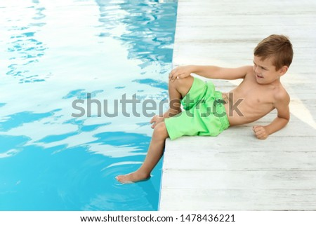 Little child near outdoor swimming pool. Dangerous situation #1478436221