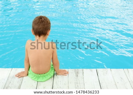 Little child near outdoor swimming pool. Dangerous situation #1478436233