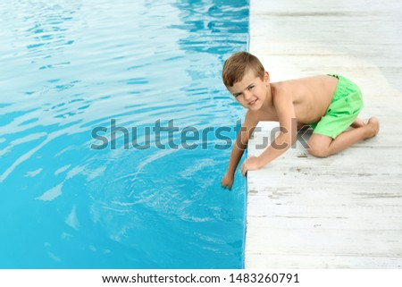 Little child near outdoor swimming pool. Dangerous situation #1483260791