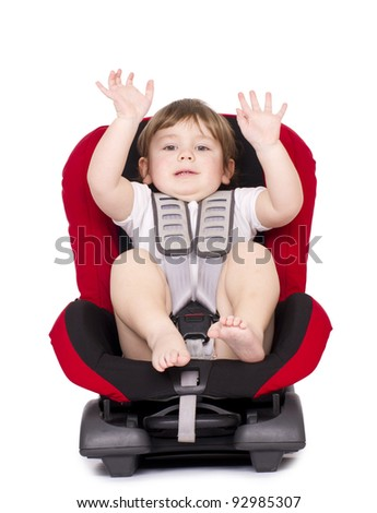 Little child on vehicle car safety seat with belt. Isolated on white.