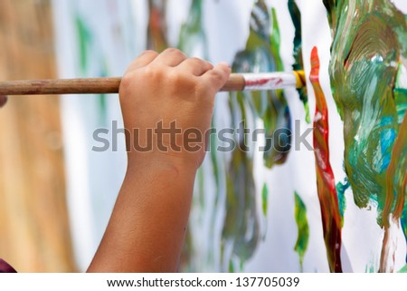 Little Child Painting With  Brush