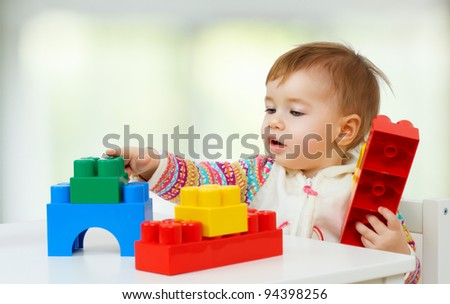 little child playing with with toys