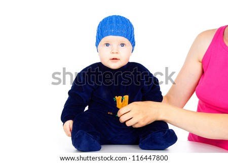 little child sits isolated on a white background