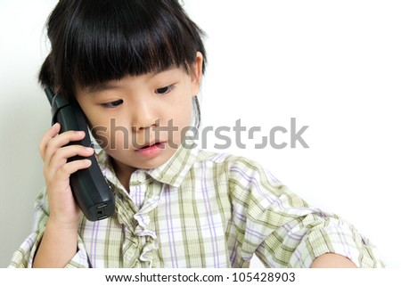Little child speaking on the mobile phone
