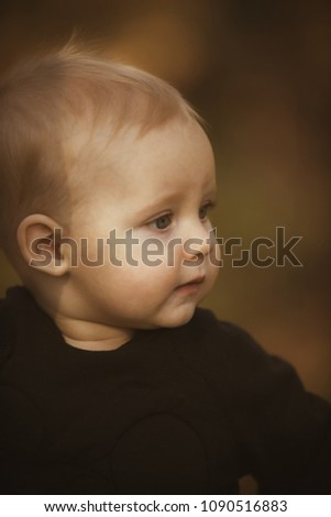 Little child with blond hair outdoor. Baby boy on blurred nature. Kid with adorable face. Childhood innocence and tenderness concept. #1090516883