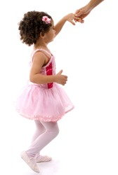 Little child with pink clothes giving hand .