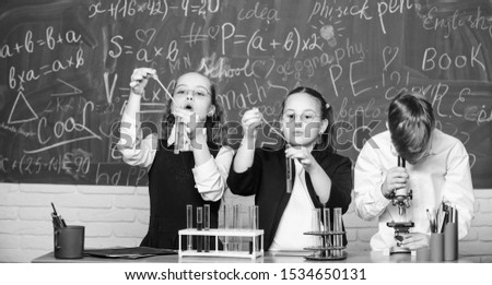 Little children at school lesson. students doing experiments with microscope. happy childrens day. Chemistry. Back to school. Little kids learning chemistry in school lab.What seems to be a problem